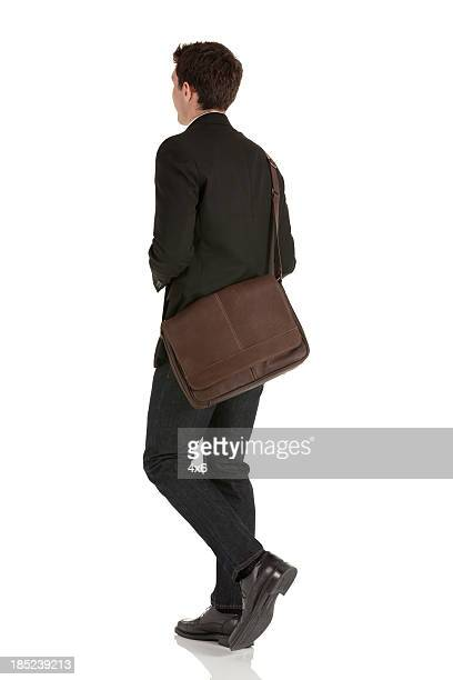 Profile of a businessman walking