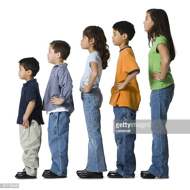Profile of a children in profile with their hands on their hips