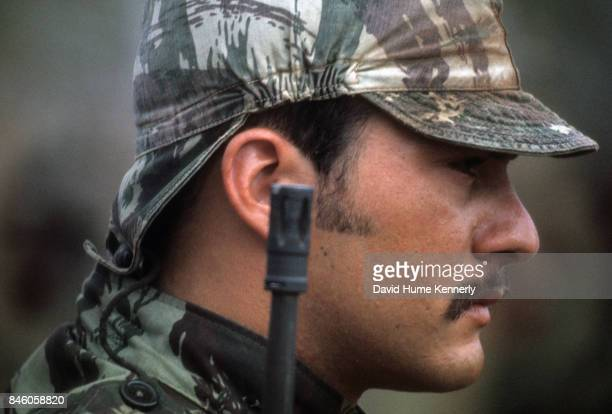 Profile of a Colonial Portuguese soldier as he stands at attention during the Mozambican War of Independence Ancuabe Cabo Delgado Province Mozambique...