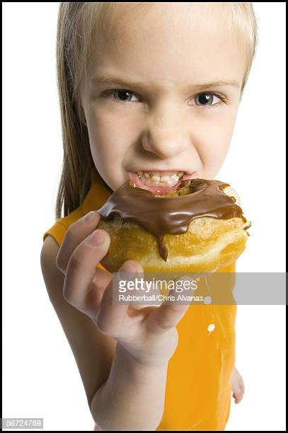 profile of a girl eating a donut - fat people eating donuts stock pictures, royalty-free photos & images