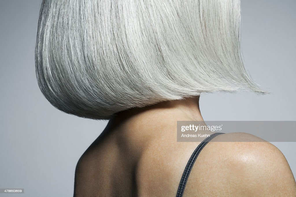 Profile of a grey haired woman in a bob, cropped. : Stock Photo