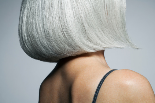 Profile of a grey haired woman in a bob, cropped. - gettyimageskorea