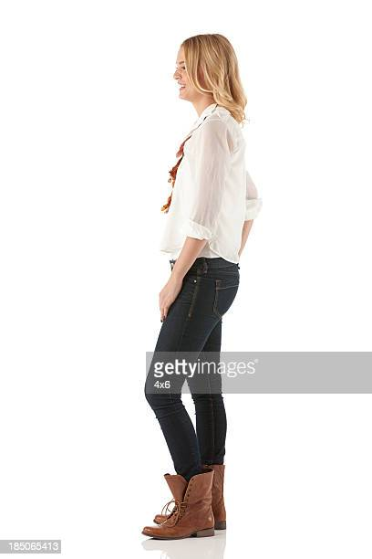 profile of a happy woman standing - van de zijkant stockfoto's en -beelden