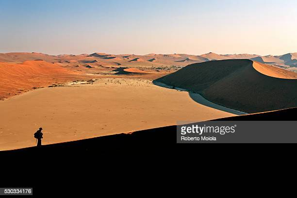 Profile of a hiker on the sand dune shaped by the wind, Deadvlei, Sossusvlei, Namib Desert, Namib Naukluft National Park, Namibia, Africa