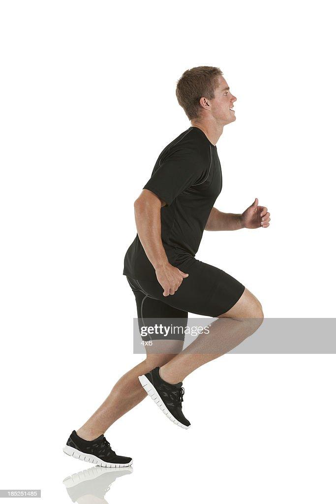 Profil eines männliche Athlet läuft : Stock-Foto
