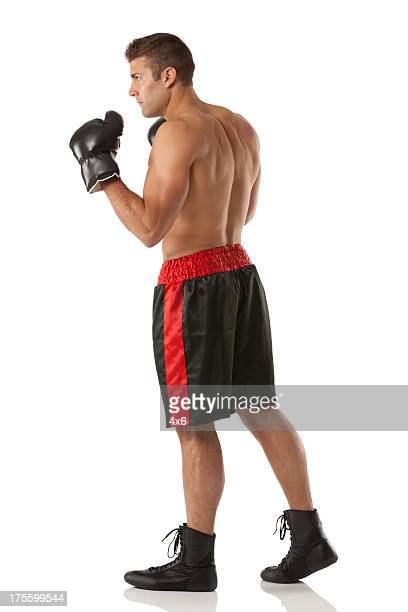 Profile of a male boxer in action