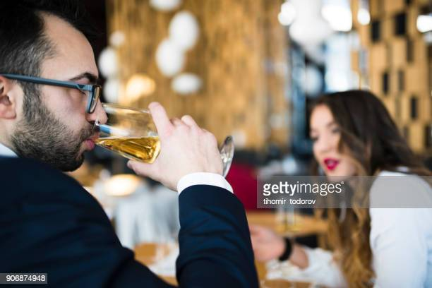 Profile of a man drinking wine at business lunch