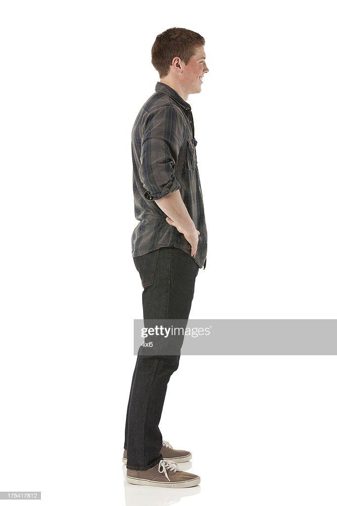 Profil von ein Mann stehend : Stock-Foto