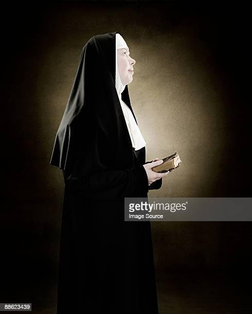 Profile of a nun praying