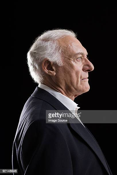 profile of a senior adult man - van de zijkant stockfoto's en -beelden