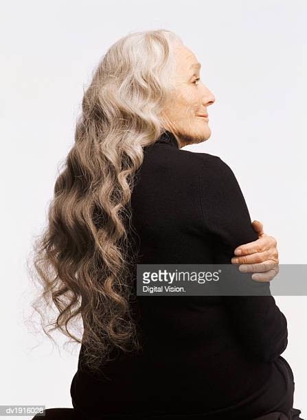 Profile of a Senior Woman with Long White Hair