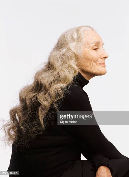 Profile of a Smiling Senior Woman, with Long White Hair