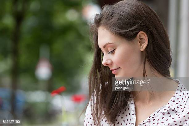 Profile of a smiling young woman