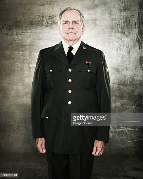 profile of a soldier saluting - one senior man only stock pictures, royalty-free photos & images