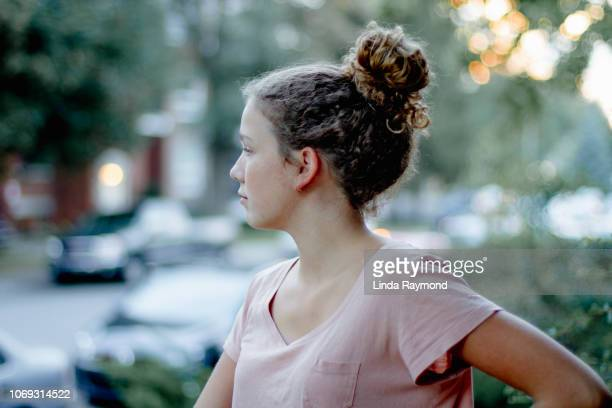 profile of a teenage girl - hair bun stock pictures, royalty-free photos & images