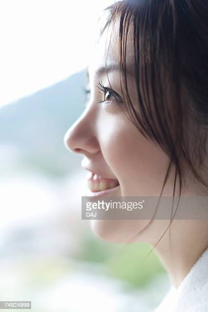 Profile of a woman in bathrobe, smiling, side view, close up, Japan