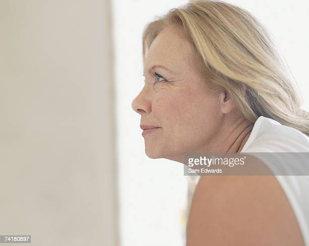 profile of a woman - one mature woman only stock pictures, royalty-free photos & images