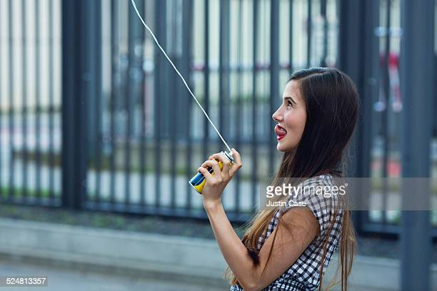 profile of a woman playing with a spray string