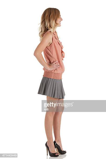 profile of a woman smiling - women wearing short skirts stock pictures, royalty-free photos & images
