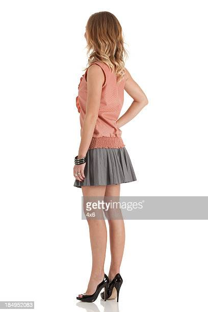 profile of a woman standing, - high heels short skirts stock photos and pictures