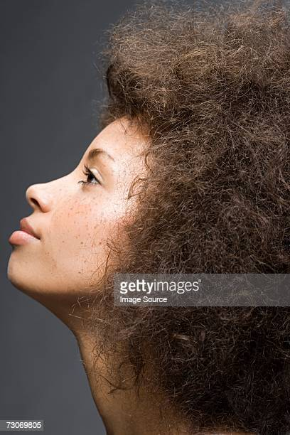 Profile of a woman with afro hairstyle