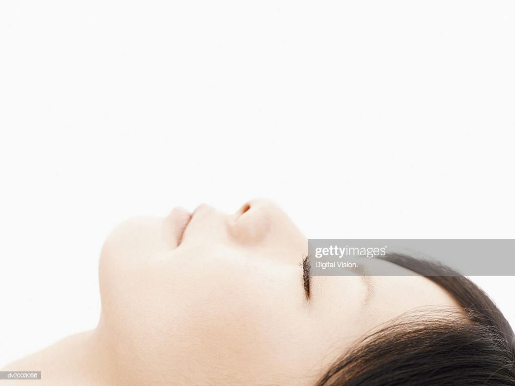 Profile of a Woman With Her Eyes Closed : Stock Photo