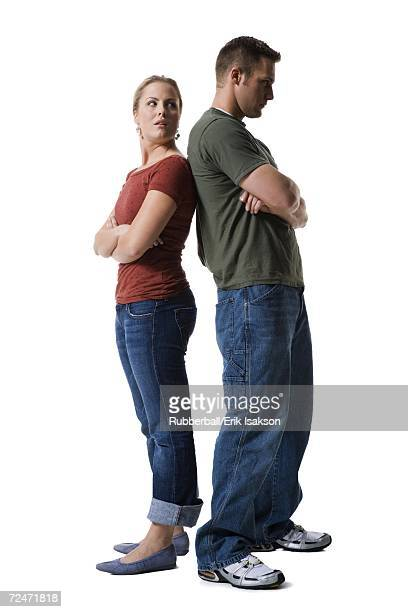 Profile of a young couple standing back to back