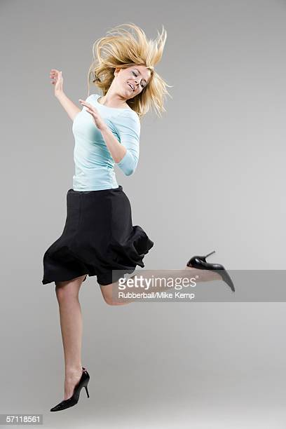 Profile of a young woman jumping