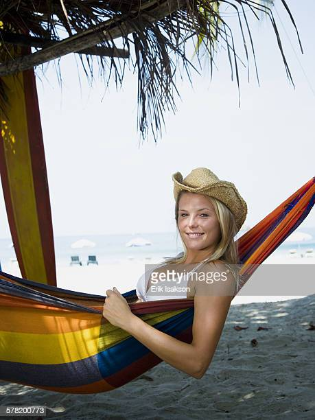 Profile of a young woman relaxing in a hammock