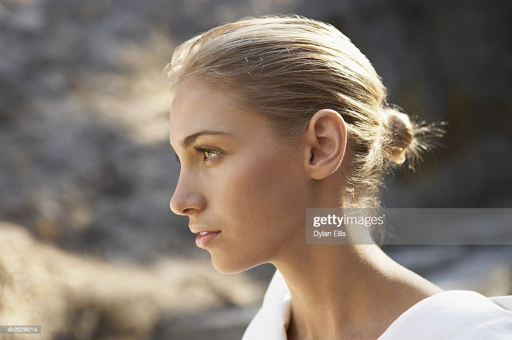 Profile of a Young Woman Wearing a Bathrobe : Stock Photo
