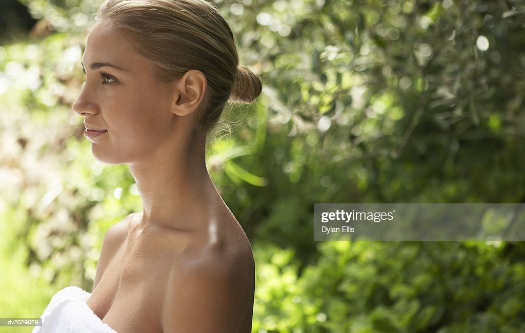 Profile of a Young Woman Wrapped in a Towel : Stock Photo