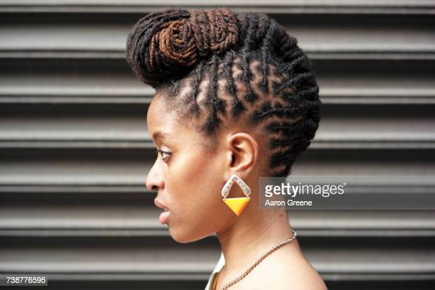 profile of african american woman with braids near metal wall - braided hair stock pictures, royalty-free photos & images