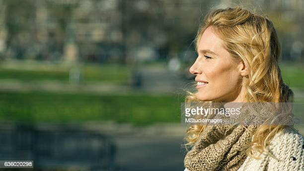 Profile of an beautiful blondy smiling woman looking away