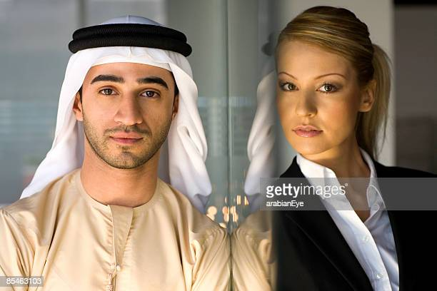 profile of an emirati man and an arabian woman. - kaffiyeh stock pictures, royalty-free photos & images