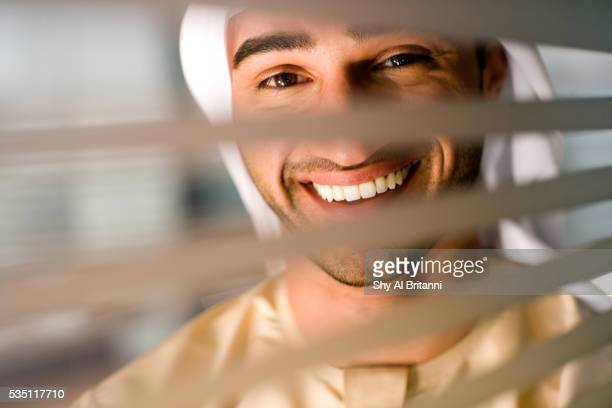 profile of an emirati man peering through a glass wall. - human body part stock pictures, royalty-free photos & images