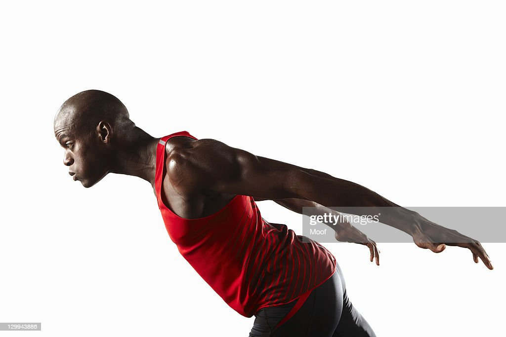 Profile of athlete lunging : Stock Photo