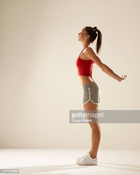 profile of athlete with arms stretched behind back - hands behind back stock pictures, royalty-free photos & images