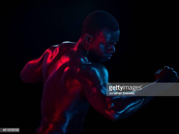 Profile of athletic male , arm raised, movement