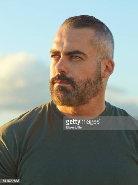 Profile of Bearded Man Closeup Sky Background