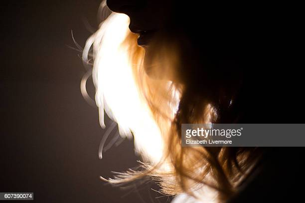 Profile of blonde woman at night