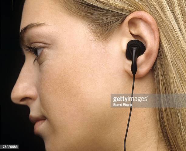 Profile of blonde woman with earphone