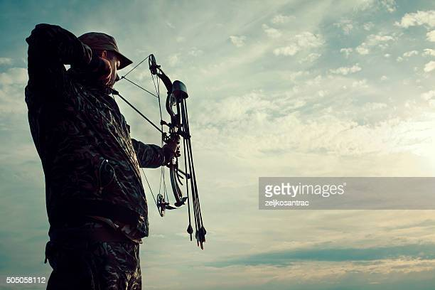 profile of bowman with bow and arrow. - archery stock pictures, royalty-free photos & images