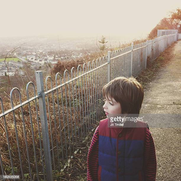 profile of boy on path observing suburbia - bradford england stock pictures, royalty-free photos & images