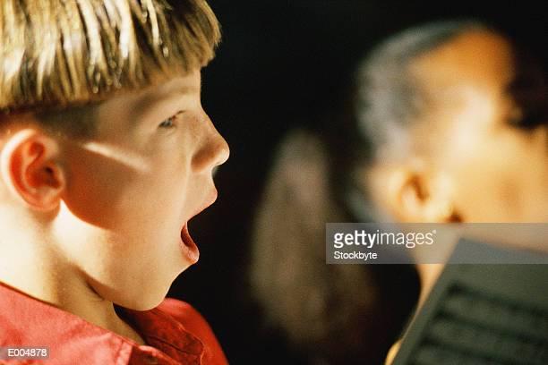 Profile of boy singing
