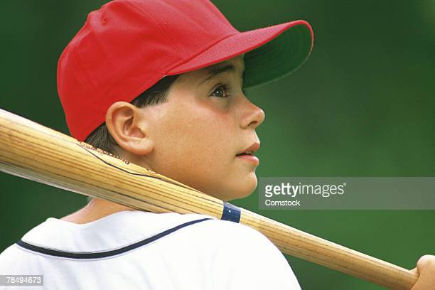 profile of boy with baseball bat - little league stock pictures, royalty-free photos & images