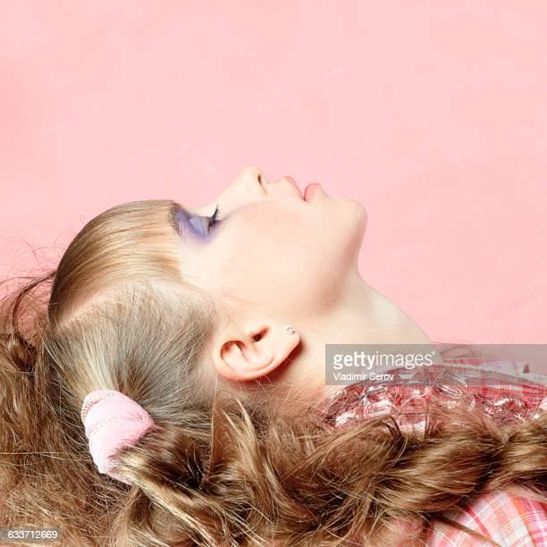 Profile of Caucasian girl wearing makeup