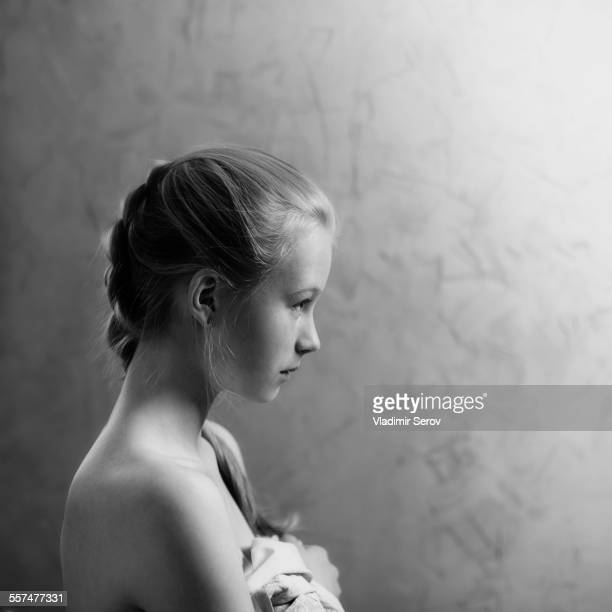 Profile of Caucasian girl with braided hair