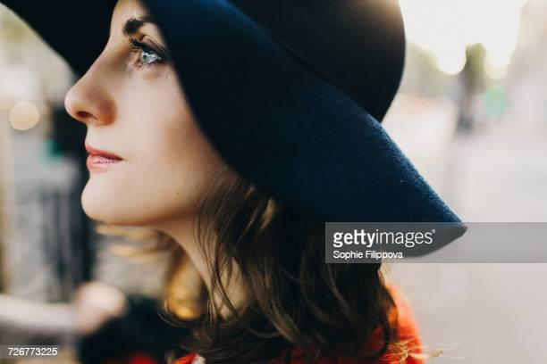 Profile of Caucasian woman wearing hat