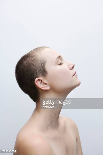 Profile of Caucasian woman with shaved-head