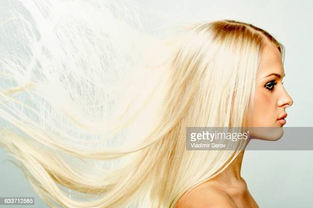 Profile of Caucasian woman with windblown hair